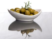 Olives 5. A small bowl of olives on a table top with the reflection in the glass Stock Images