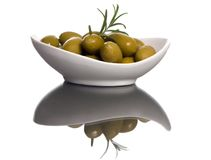 Olives 6. A small bowl of olives on a table top with the reflection in the glass Royalty Free Stock Image