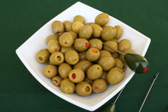 Olives. Green olives on white plate with forks beside Stock Photo