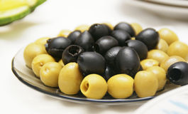 Olives are accurately laid on a plate. On the table Royalty Free Stock Photography