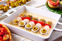 Olives anchovies and picked onion pinchos Stock Images