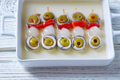 Olives anchovies and pickled onion pinchos Stock Images