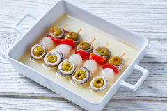 Olives anchovies and pickled onion pinchos Royalty Free Stock Image