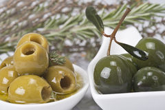 Olives and aromatic herbs Royalty Free Stock Photography