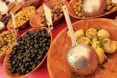 Olives and articholes for sale Royalty Free Stock Photo