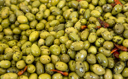 Olives backgrounds. Green olives backgrounds at the street market Royalty Free Stock Photo