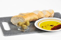 Olives, baguette and olive oil stock images