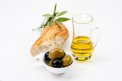 Olives, baguette and olive oil Royalty Free Stock Image