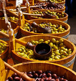Olives in barrells. Royalty Free Stock Image