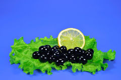 Olives black with a lemon and sheet salad Royalty Free Stock Image
