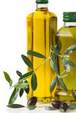 Olives and bottle with olive oil. On white Background Stock Photos