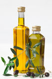 Olives and bottle with olive oil. On white Background Stock Photo