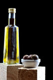Olives and a bottle of olive oil Stock Photo