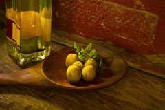 Olives and a bottle of olive oil. Closeup shot, free copy space Stock Photo