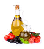 Olives and a bottle of olive. Oil with vegetables Stock Images