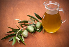 Olives and a bottle of olive oil Royalty Free Stock Images
