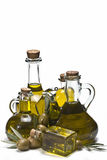 Olives and bottles of olive oil. Stock Images