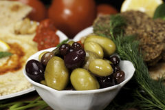 Olives in bowl. With Falafels and Humus Royalty Free Stock Photography