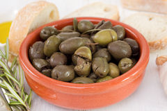 Olives in the bowl with garlic Stock Images