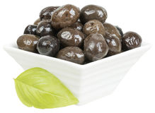 Olives. In a bowl on isolated background Stock Photos