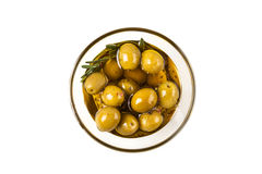 Olives in bowl isolated. Olives and olive oil in glass bowl with rosemary isplated on white Royalty Free Stock Image