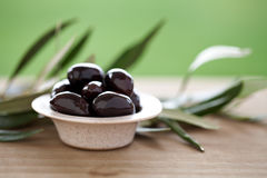 Olives. In bowl and olive leaves Royalty Free Stock Photography