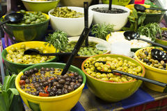 Olives in bowls in a shop Royalty Free Stock Images