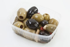 Olives in box against white background Royalty Free Stock Images