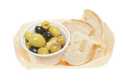 Olives and bread in a basket Royalty Free Stock Image
