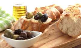 Olives and bread. Close up of bread with olives Stock Image