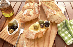 Olives and bread. Close up of bread with olives Royalty Free Stock Photography