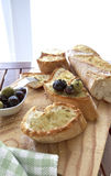 Olives and bread. Close up of bread with olives Stock Photo