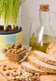 Olives, bread, seed and olive oil. Royalty Free Stock Image