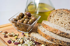 Olives, breag, seed and olive oil. Royalty Free Stock Image