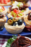Olives in bred cup, appetizer series Royalty Free Stock Image