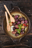 Olives in brine Stock Photos