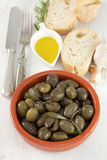 Olives in brown ceramic bowl with olive oil Stock Photos