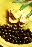 Olives and bruschette Stock Images