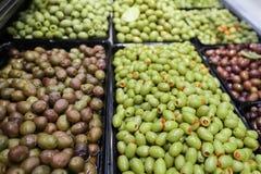 Olives bulk. Various types of olives in bulk store sale stock images
