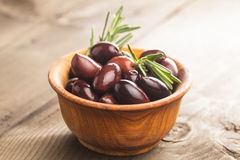 Olives calamata. In wooden bowl on the table Royalty Free Stock Images