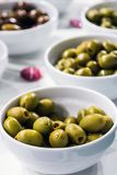 Olives canned meats of different varieties on the table Stock Photo