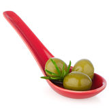 Olives on ceramic spoon Royalty Free Stock Photo