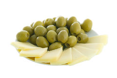 Olives and cheese. On a plate isolated on white Royalty Free Stock Image