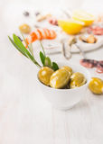 Olives with cheese  and branch of  olive tree Royalty Free Stock Photos