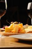 Olives, cheese and grapes. On a wooden restaurant table stock photos