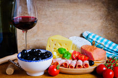 Olives, cheese, ham and wine Royalty Free Stock Photography