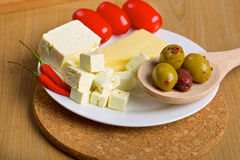 Olives, cheese and tomatos on a plate Stock Photography