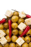Olives and chili pepper and shards sheep cheese Stock Image