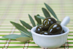 Olives in a china spoon Stock Photo