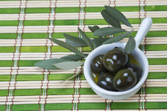 Olives in a china spoon Stock Photography